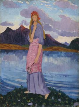 Girl standing by a lake