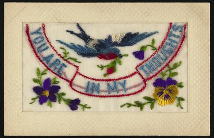 Embroidered postcard inscribed 'YOU ARE IN MY THOUGHTS'. Handwritten message on back. Dated 2 September 1917. Probably sent to Miss Evelyn Hussey, sister of Corporal Hector Hussey of the Royal Welch Fusiliers, during the First World War.