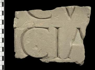 Stone tablet with inscription from fortress baths