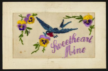 Embroidered silk postcard inscribed Sweetheart Mine. Sent from France by Tom Hardiman to his girlfriend (later wife) Hilda Hobbs during First World War. Undated. Embroidered with bluebird and pink and yellow pansies. Message on back.