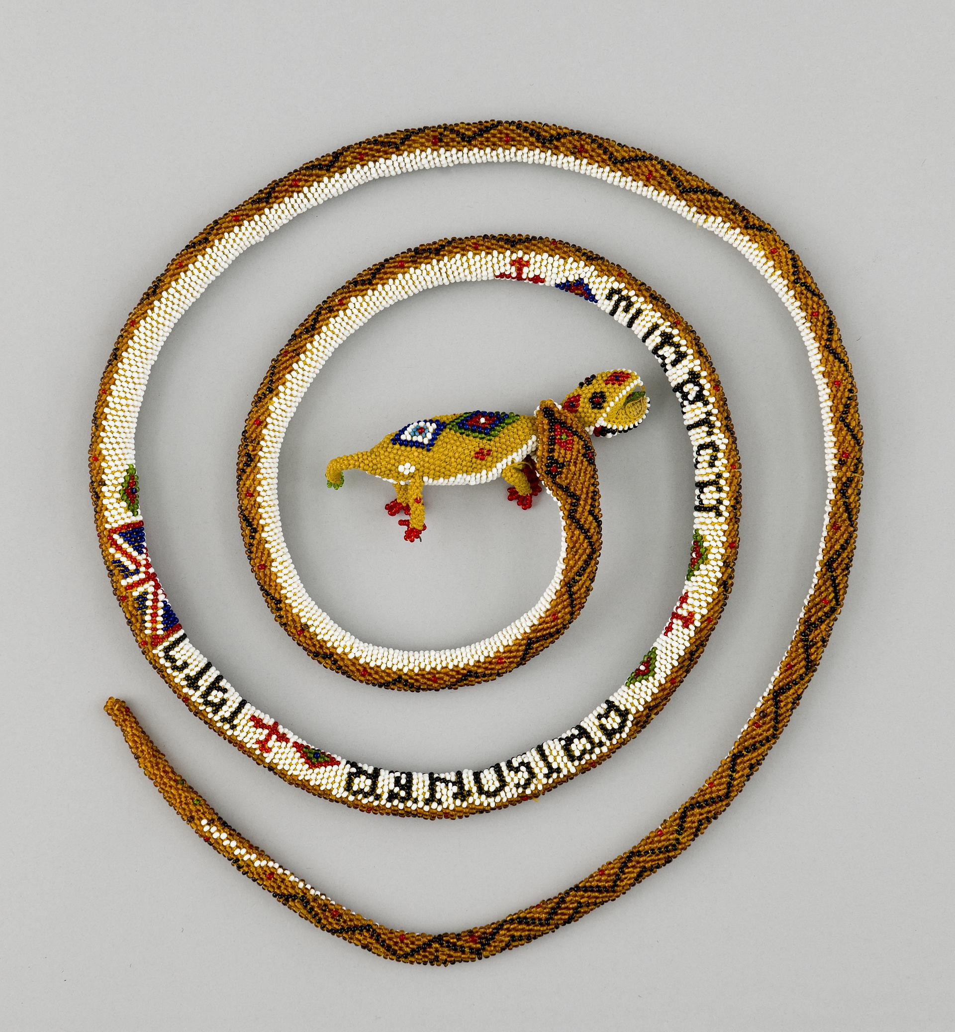 Open the image &lsquoBeadwork model of a snake holding a chameleon'