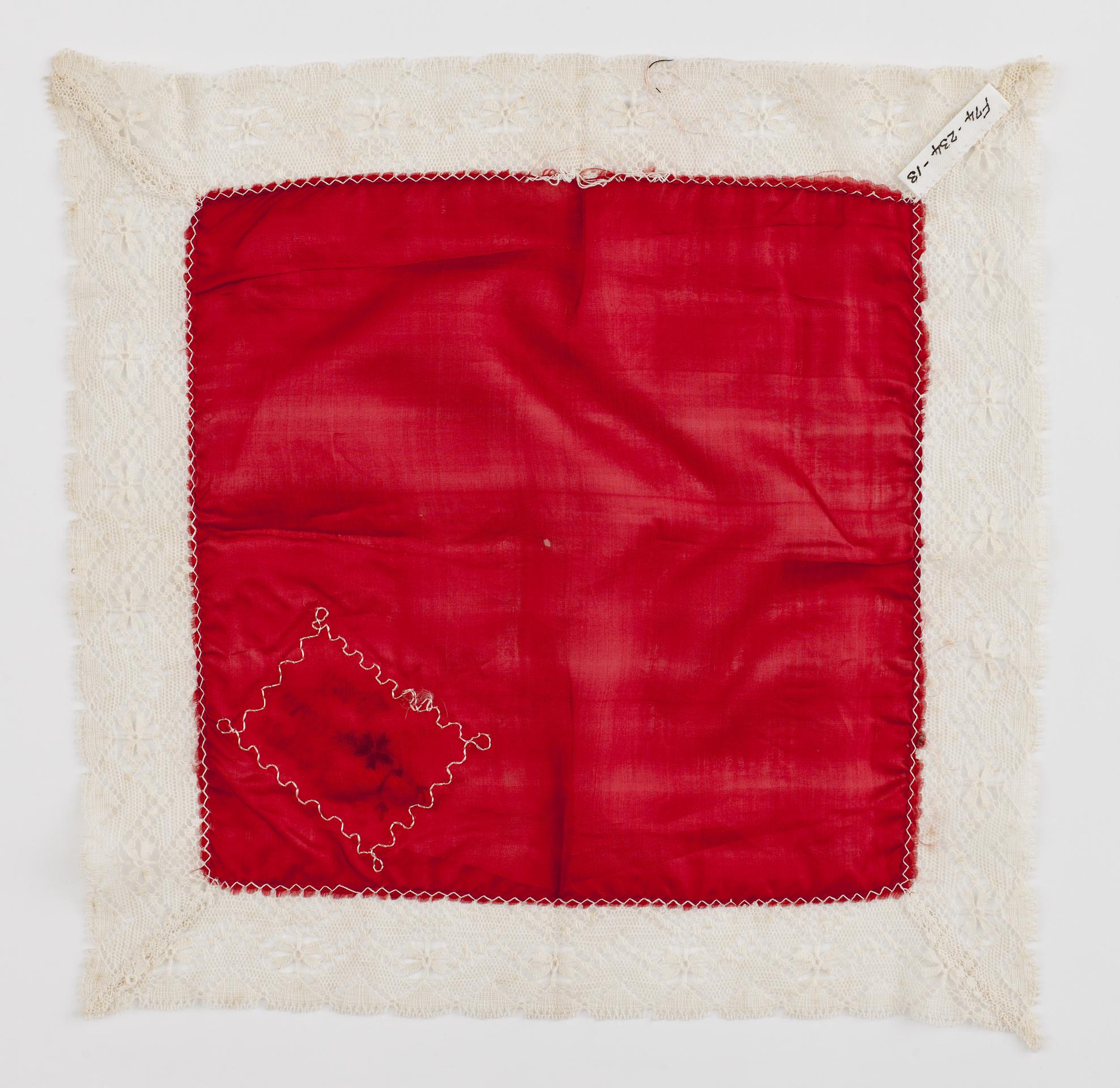 Open the image &lsquoRed silk handkerchief embroidered with the inscription 'To my dear Mother'.'