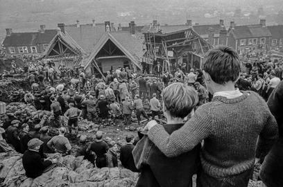 GB. WALES. Aberfan Coal Slip Disaster.  Two surviving children stand at the top of the hill overlooking the miners digging to find children still buried in the slag.  Over one hundred children in the apparent safety of their school were buried under the waste of a sliding coal tip. 1966.