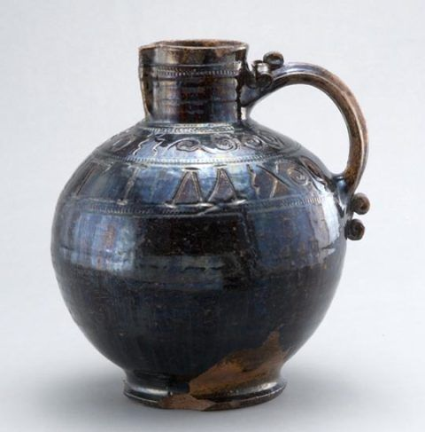 Incised earthenware harvest jug, made in Gestingthorpe, Suffolk, in 1680. Purchased 1904.