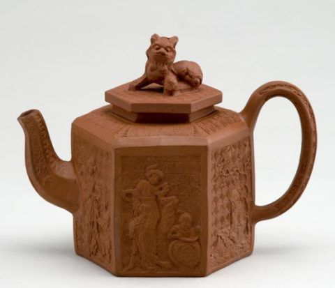Red stoneware teapot with moulded chinoiserie decoration