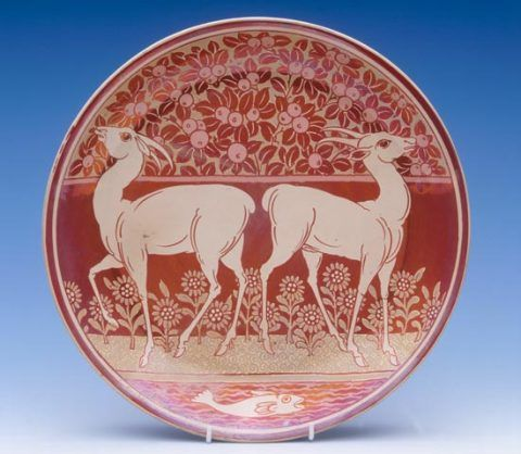 Earthenware dish painted in red and gold lustre by William de Morgan