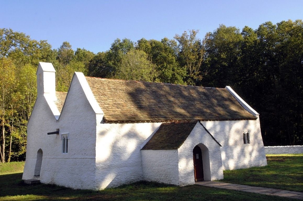 St Teilo's, a white church in a woodland setting