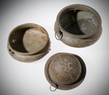 The hoard group of two bowls and a wine-strainer