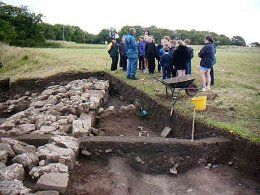 Mark Redknap conducting a site tour in front of Mark Lodwick's trench.