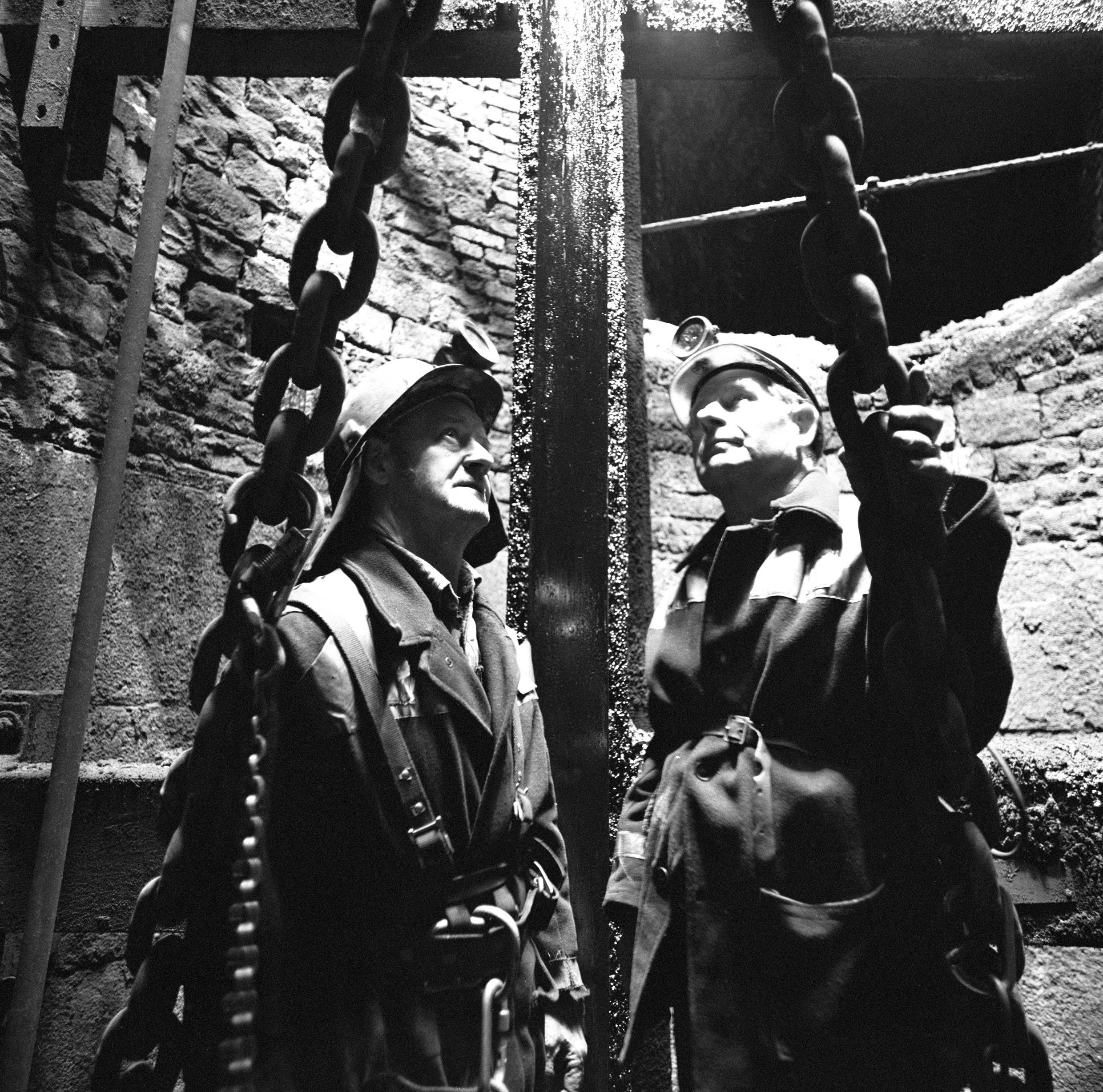 Deep Duffryn Colliery, two pitmen inspecting the shaft from the roof of the cage, 1977-78.