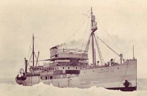 Royal Research Ship <em>Discovery II</em> in loose pack ice, Bouvet Island, Southern Ocean, 1926.