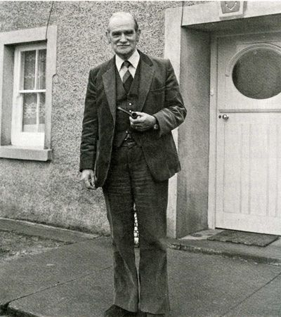 W. R. Evans at the door Glynsaithmaen, his home.