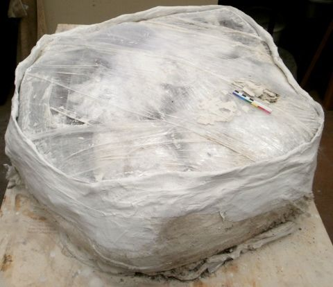 The Clingfilm layer which had been protected the iron underneath from the Plaster of Paris bandages. The sides of the block had been carefully re-bandaged to ensure that the soil block held together.