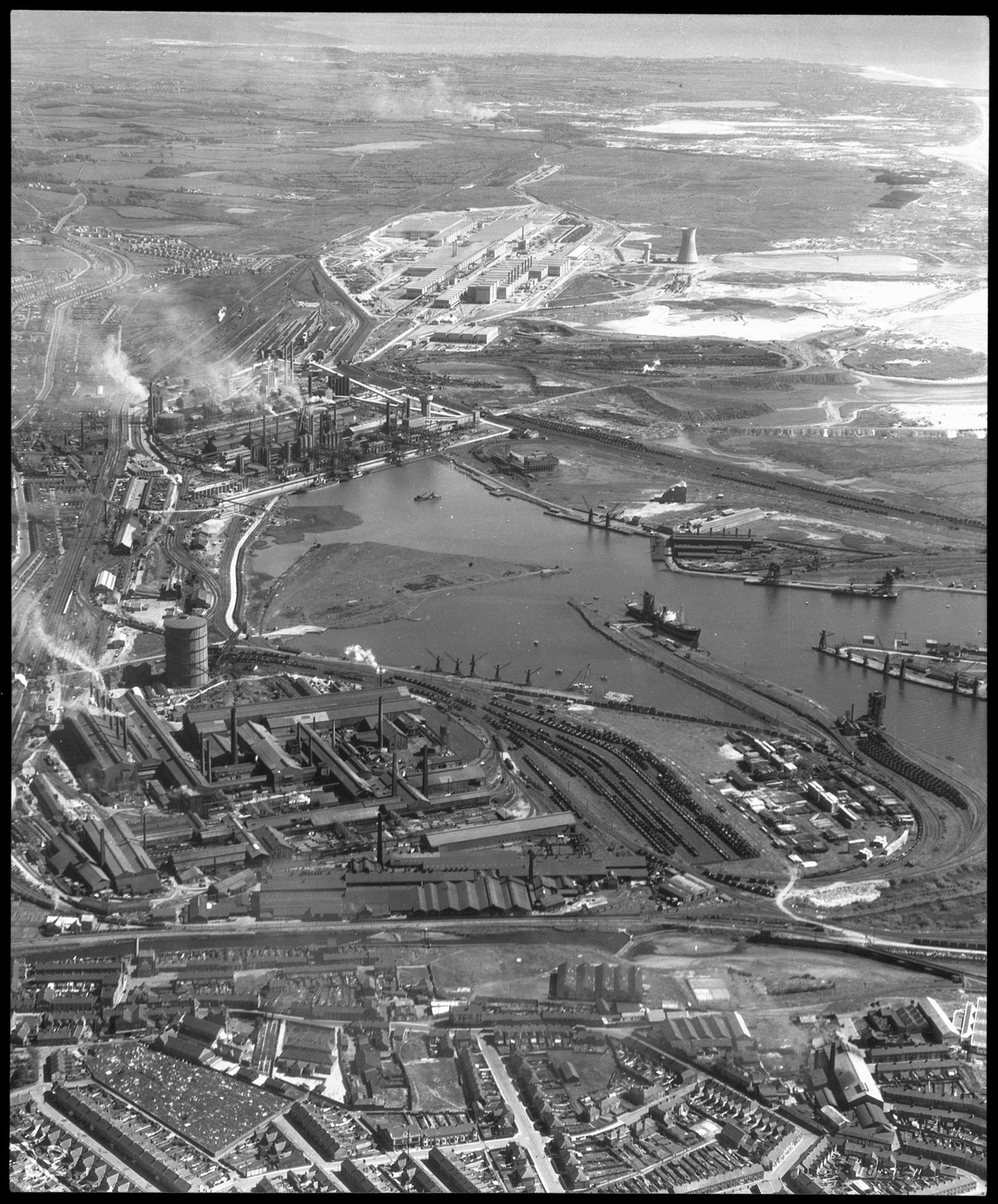 Aerial view of Port Talbot Steelworks in foreground, Margam Steelworks at middle distance and Abbey Steelworks in the far distance, 1952.