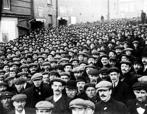 Miners waiting to go into the mass meeting at Empire theatre, Tonypandy on the 9th November 1910 (b/w photo)