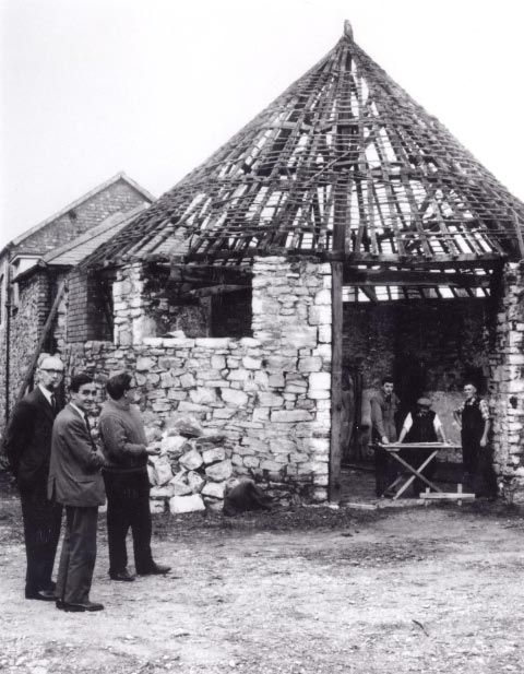 The Cockpit in Denbigh, prior to removal to St Fagans National History Museum. Also in the picture are Dr Iorwerth C. Peate, Frank Price Jones and J. Geraint Jenkins