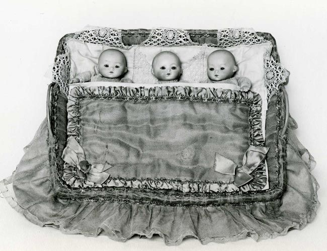 Set of three miniature <em>bisque</em> dolls, c.1920-25