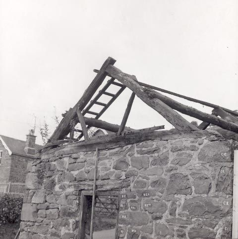 Dismantling the Smithy in Llawr-y-glyn prior to removal to St Fagans National History Museum