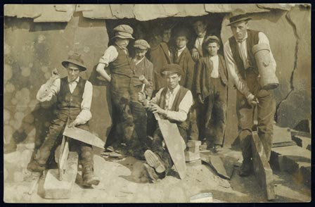 Quarrymen splitting and dressing slate at Dinorwig, 1921