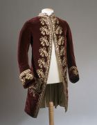 Velvet coat embroidered with silks and gold sequins.