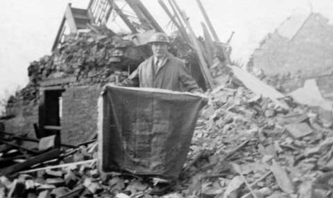 The flag being retrieved from the rubble of the scout hall in Wyverne Road, Cathays, Cardiff after the German bombing raid of 30 April 1941