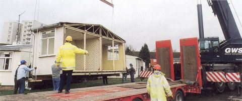 The Historical Buildings Unit dismantling the prefab at Llandinam Crescent in November 1998.