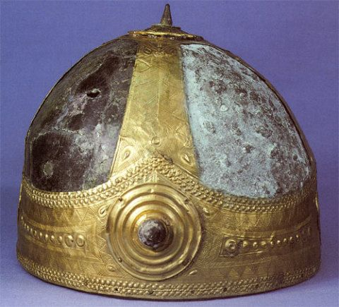 Etruscan bronze 'helmet' embellished with gold showing half of the false patina removed