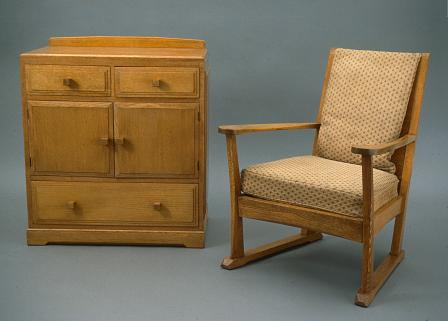 Talybont cupboard-chest and Ynysddu armchair by the Brynmawr Furniture Company.