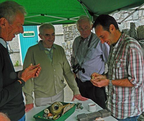 PAS Cymru Finds Co-ordinator conducting a find identification day at Penmaenmawr, Conwy
