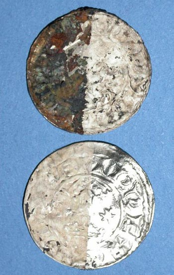 Part-cleaned and fully-cleaned coins. Each coin measures about 2cm (0.75 inches) across.