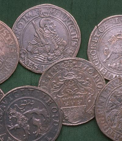 Talers: large silver coins from Germany.