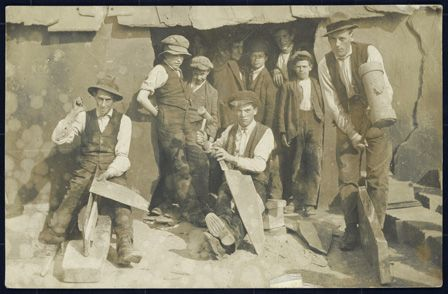 Quarrymen splitting and dressing slate at Dinorwig Slate Quarries