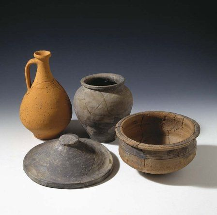 Range of vessels found at Usk Roman fortress - a flagon for drinking, a jar for storage, a bowl for mixing or cooking, and a large lid, probably used during cooking.