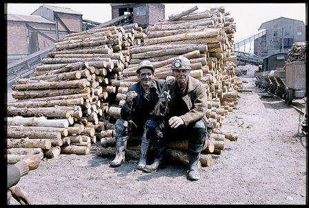 Two miners having a cigarette in the timber yard, Big Pit