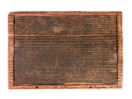 The first 'page' of a Roman will found near Trawsfynydd in the 19th century. The tablet was already broken in two.