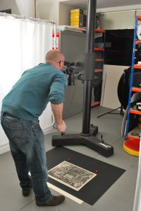 Here you can see our colleague Robin Maggs taking photographs about the prints in the studio.