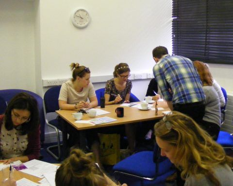 Members of the National Museum Wales Youth Forum and volunteers at the Cardiff Story writing their stories.