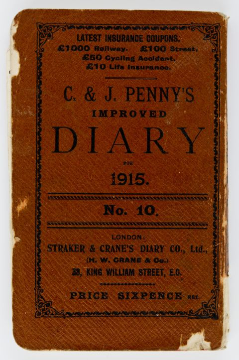 Diary with a red cover and the words C. & J. PENNY'S IMPROVED DIARY FOR 1915 in black ink