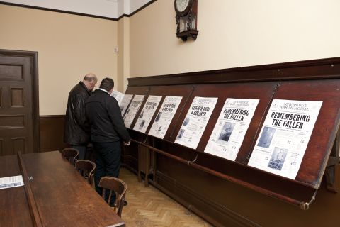Replica broadsheet newspapers displayed on stands in the Reading Room of Oakdale Institute.