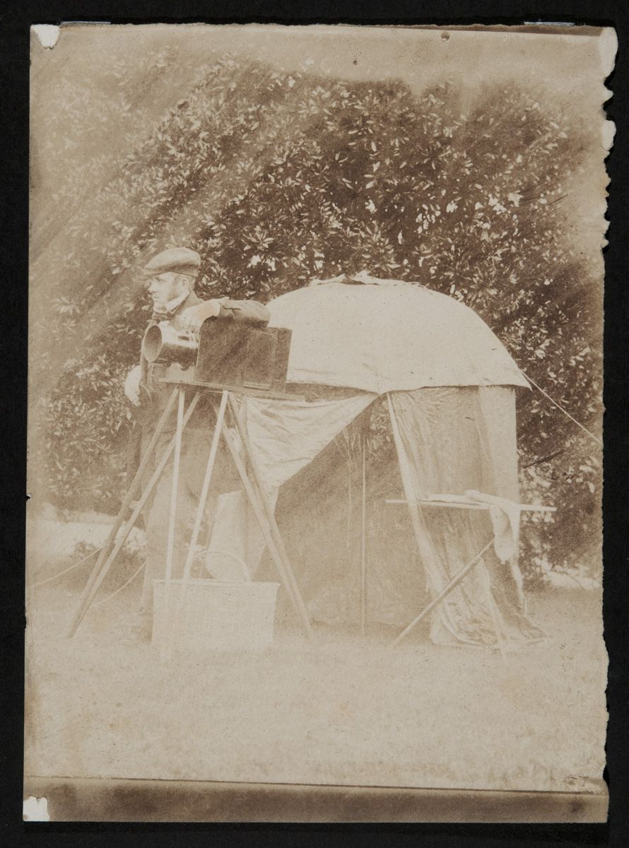 Salted paper print showing John with all the apparatus needed to take a collodion negative
