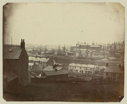This photograph was made using the Oxymel process. It was taken on 15 March 1858 at 1pm with an exposure of 15 minutes. It shows Swansea from St. Thomas, and sailing vessels can be seen in the background.