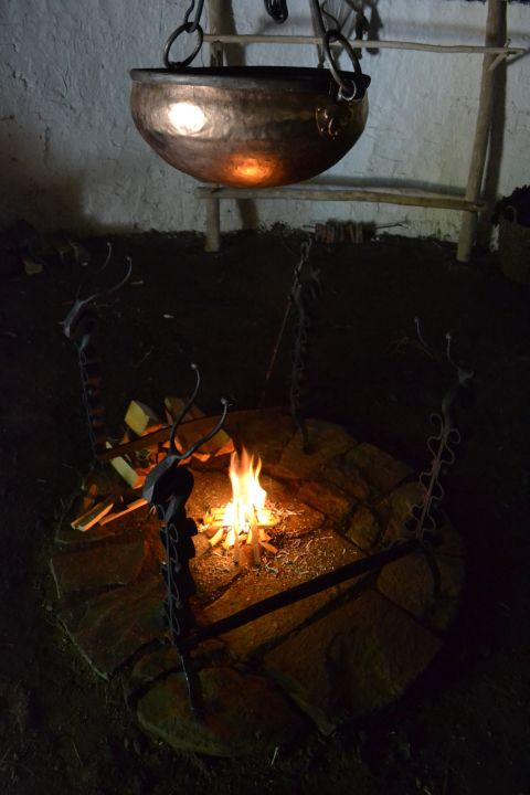 An image of the cauldron hanging above the fire