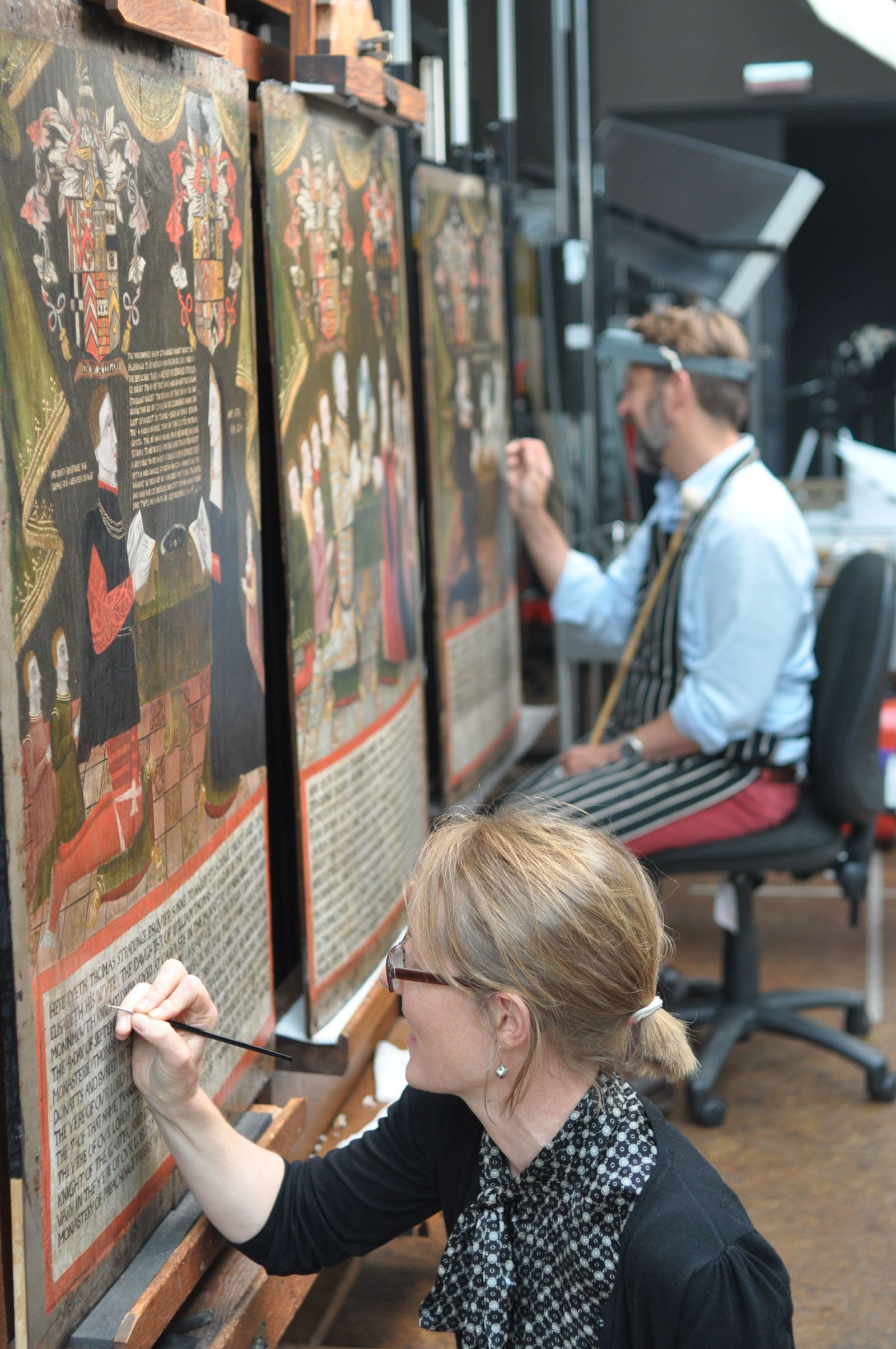 Art conservators at work