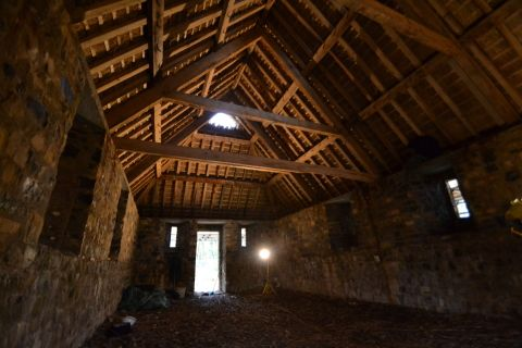 View of interior of hall after thatching.