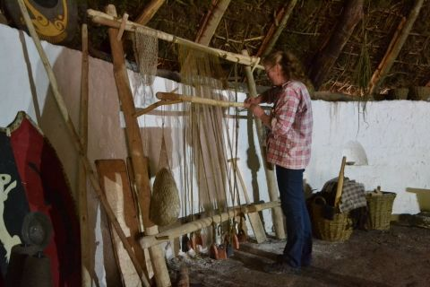Image of woman weaving within Bryn Eryr roundhouse.