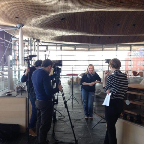 Rachel Cable being interviewed at the National Assembly for Wales