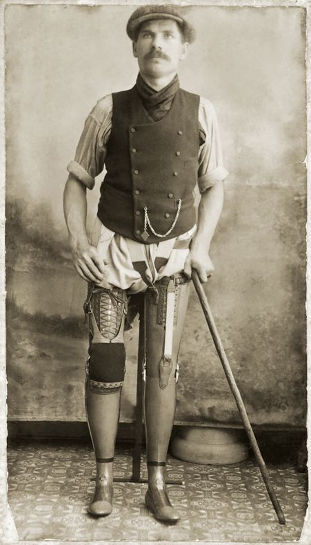 Studio portrait of George Preece wearing his prosthetic legs
