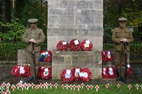 Picture of soldiers at a war memorial