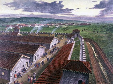 Barracks and other buildings in the west corner of the Roman legionary fortress, Caerleon, Monmouthshire, in the 2nd century AD; by Alan Sorrell, 1939. This reconstruction shows one corner of the barracks in Prysg Field, now laid out and on view to the pu