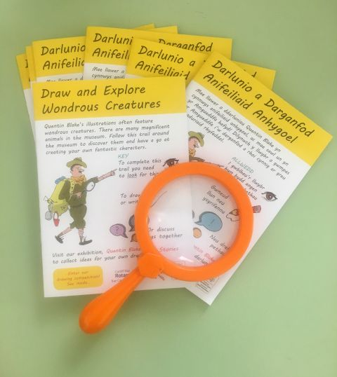 Activity booklets with magnifyning glass.